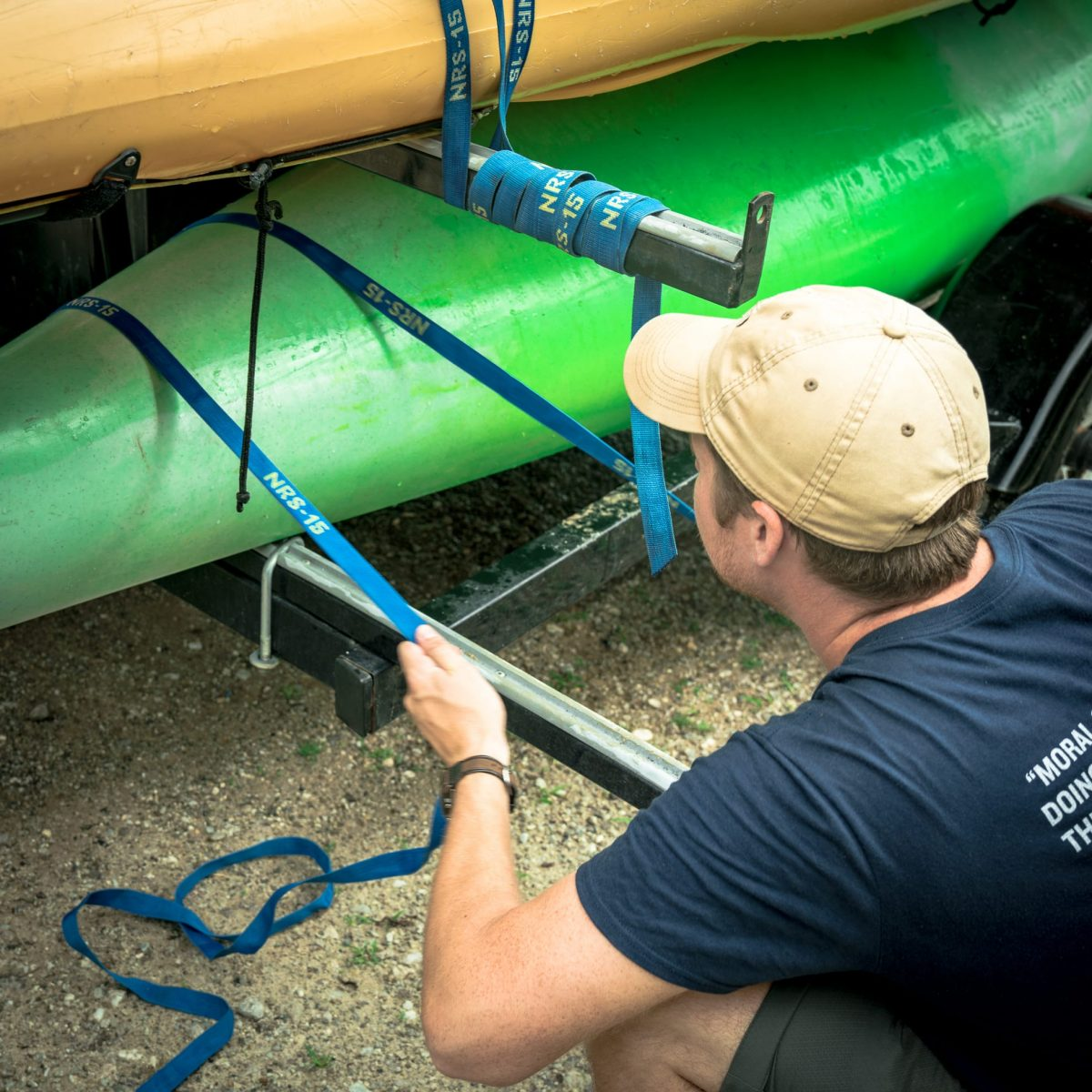 Instructors preparing for an expedition by securing a set of kayaks.