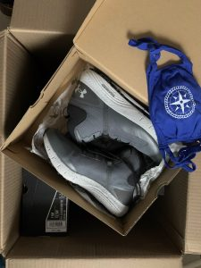 Under Armour boots in their box