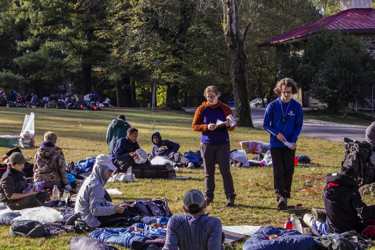 Two instructors prepare a group of students for their first Outward Bound course.