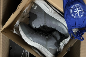 Under Armour boots and a face mask packaged up
